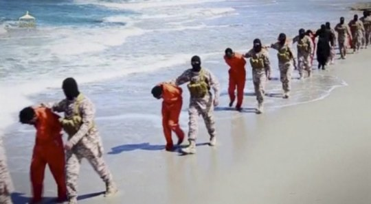 Islamic State militants lead what are said to be Ethiopian Christians along a beach in Wilayat Barqa, in this still image from an undated video made available on a social media website (Reuters)